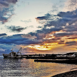 boat in sunset by Adriana Kastelan - Transportation Boats