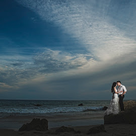 Love is a canvas furnished by Nature and embroidered by imagination. by Yansen Setiawan - Wedding Bride & Groom ( lovers, wedding day, weddings, wedding, bride and groom, beach, trash the dress )