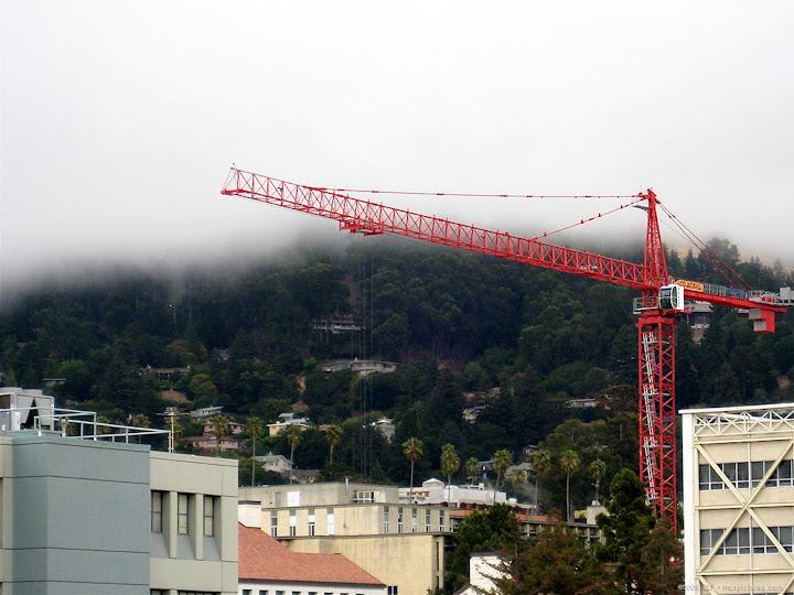 Crane, fog, hills