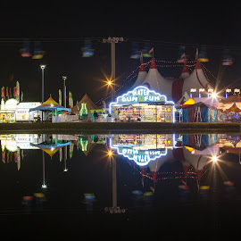 Fair Reflections by Donna Vasquez - City,  Street & Park  Amusement Parks ( water, games, sky lift, nigh, reflection, starburst, amusement park, amusement, neon, tent, fair, circus )