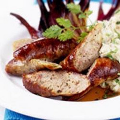 Sausages With Mashed Veg And Red Onions