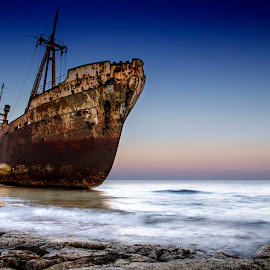 The Shipwreck by Bouras Panagiotis - Transportation Boats ( damaged, collapsing, reflection, wheel, underwater, ship, ruin, solitude, ocean, travel, ghost, beach, iron, coast, island, gytheion, naval, rusting, shipwreck, destroyed, dark, sparti, trip, corrosion, water, marine, mani, sunk, loneliness, greek, wreck, greece, navigate, under, sea, lakonia, seascape, steps, touristic, sunset, day, navy, bridge, diving, nautical )
