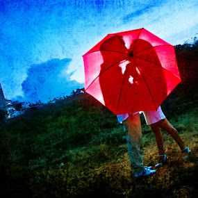 Love under in Red Umbrella by Roland Caranzo - People Couples ( roland caranzo, caranzodigital, wedding photographers, portrait photographers, cebu photographers )