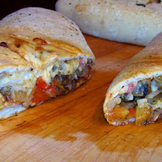 Stromboli With Prosciutto, Peppers, Onions, Garlic & Shrooms