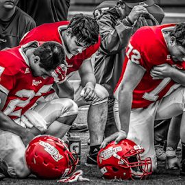 When you care, defeat is painful by Brandon Stivers - Sports & Fitness American and Canadian football ( football, selective color, emotional, black and white, game, pwc )