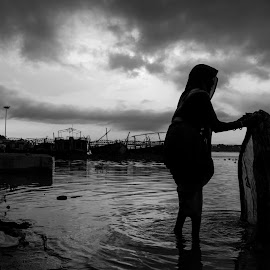 Washing by the river... by Shashwat Prakash - People Street & Candids ( clouds, ganga, black and white, clothes, vista, lady, drama, dirt, washing )