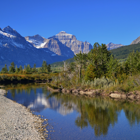 St Mary river by Don Evjen - Landscapes Waterscapes ( forests, mountains, montana, glacier park, river )