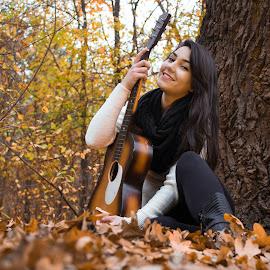 Beautiful autumn . by Daniel MV - People Musicians & Entertainers ( girl, tree, autumn, beautiful, carpet, guitar, leaf, smile, hair )