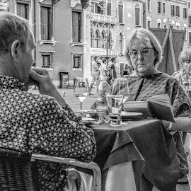 romantic dinner, Not! by Vibeke Friis - City,  Street & Park  Street Scenes ( woman, disinterested, restaurant, man,  )