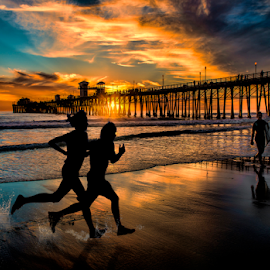 Beach Runners by Alan Crosthwaite - People Street & Candids ( beach backgrounds, oceanside, beach sunsets, southern california, fitness, oceanside pier, pier backgrounds, tourism, travel, running, coastal, destination, silhouetted, san diego, piers, sunset, travel backgrounds, silhouettes, pier, pier sunsets, runners, friendship. )