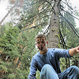 Man Jumping over Fence by Matt Dittsworth - People Portraits of Men ( face, tree, sequoia, paint, boy, man, jump, giant )