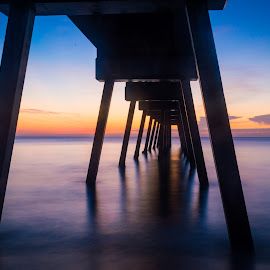 Sunset under the pier by Bradley Wilson - Landscapes Sunsets & Sunrises ( water, shadow, pier, ocean, sunrise )