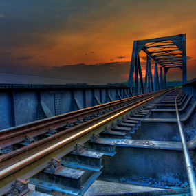 The Track by Charliemagne Unggay - Transportation Trains ( building, railway, sunset, bridge, architecture )