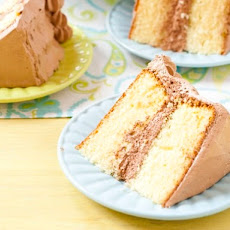 Yellow Birthday Cake with Fluffy Chocolate Ganache Frosting