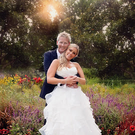 Love Amongst the Flowers by Alan Evans - Wedding Bride & Groom ( wedding photography, melbourne wedding photographer, park, pathway, melbourne, aj photography, wedding dress, melbourne botanic gardens, wedding gown, wedding, botanic garden, path, trees, bride and groom, bride, flowers, garden, groom, bride groom )