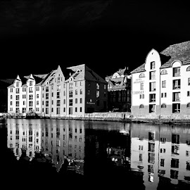 Alesund by Lonnie Scott - Buildings & Architecture Office Buildings & Hotels ( water reflections, waterfront, norway, woman, b&w, portrait, person )