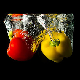 Playing with my food! A little water play today.# by James L. Neihouse - Food & Drink Fruits & Vegetables ( water, splash, red, yellow, bubbles, freeze_motion, strobe, canon, 1dc, cine_primes, instagood, peppers )