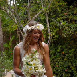 Candid by the pool. by Alexandre Ribeiro Dos Santos - Wedding Bride ( wild, bouquet, sumba, nature, villa, pool, wedding, indonesia, resort, nihiwatu, bride, flowers )