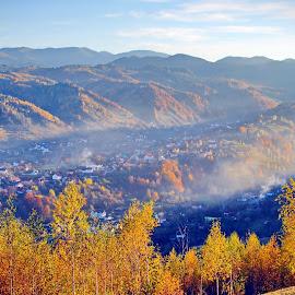 Autumn in Bran Romania by Dan Baciu - Landscapes Mountains & Hills ( colors, romantic, romania, bran castle, moeciu, country, foggy, life, village, autumn, sunset, fall, sunrise, smog, bran, peasant, color, colorful, nature )