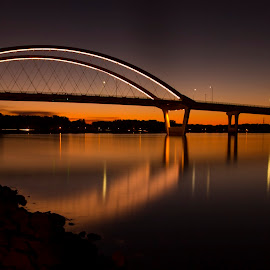 Bridge Over Calm Waters by Bill Kuhn - City,  Street & Park  Skylines ( arch, sunset, long exposure, bridge, hastings, river, mississippi )