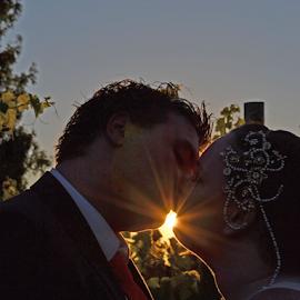 Let the Sunshine Through by Jessica Hensley - People Couples ( wedding photography, kissing, sunset, wedding, sunshine )