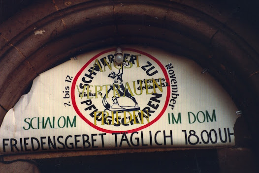 Swords to Ploughshares motif over church entrance in East Berlin