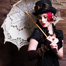 Old Time by Cheree Smith - Novices Only Portraits & People ( studio, girl, thinking, inside, umbrella, steam punk, fashion, urban portrait, urban fashion, unique outfit )