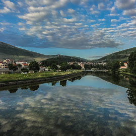 Mirror image by Irena Perkušić - Landscapes Cloud Formations ( clouds, trebinje, sirena, river )