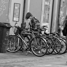 woman with bicycle by Renato Dibelčar - City,  Street & Park  Street Scenes ( strasse, woman, street, slovenia, maribor, blackwhite, mann, man, bicycle )