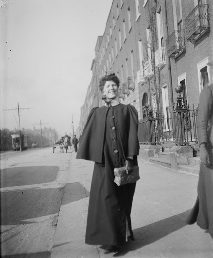Nurse walking on Merrion Square, close to the maternity hospital on Holles Street