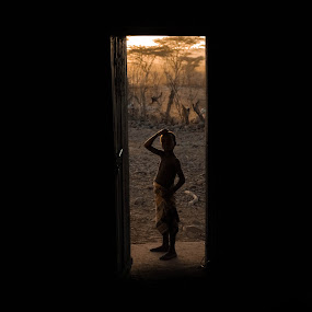 It leads to another world... by Dragos Birtoiu - Babies & Children Children Candids ( child, curiosity, door, africa, darkness, world )
