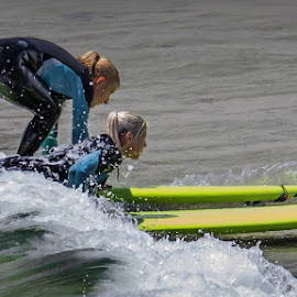 Becoming Surfers by Duncan Rea - Sports & Fitness Surfing ( girl, surfing, beach, surf )
