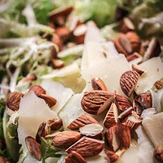 Shaved Fennel Salad With Frisée, Almonds, and Raisins