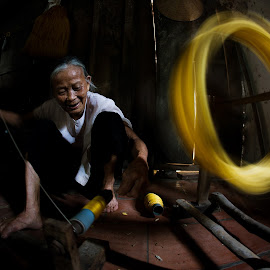 Golden Silk by Ngo Huy - People Street & Candids ( silk, rotary, vietnam, golden, grandmother )