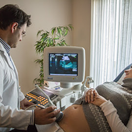 It's a ... girl ! by Arti Fakts - News & Events Health ( girl, news, test, analusis, happy, pregnant, cabinet, ultrasound, gynecologist, good, artifakts, doctor )