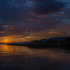 Sunset over Hartebeestpoort Dam by Nicholas Sykes - Landscapes Sunsets & Sunrises (  )