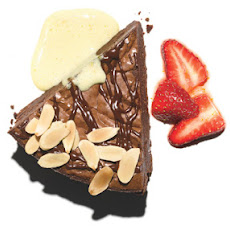 Chocolate Truffle Pie with Orange-Champagne Sabayon and Strawberries