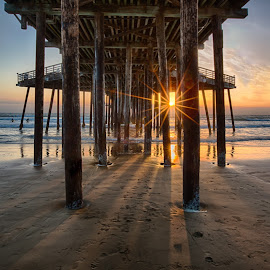 Pismo Pier Sunburst by Tom Reiman - Landscapes Sunsets & Sunrises ( colorful, sunset, pier, pismo, central california, seascape )