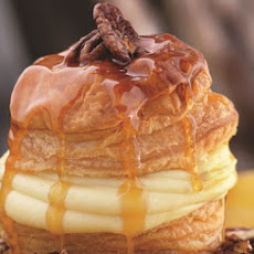 Soufflé of Puff Pastry with Orange-Scented Pastry Cream, Candied Pecans, and Caramel Butter Sauce