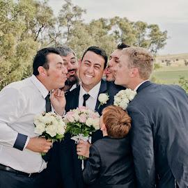 kissy Kissy by Alan Evans - People Street & Candids ( groomsmen, wedding photography, kissing, aj photography, wedding flowers, wagga wedding photographer, fun, wedding fun, field, kiss, wedding, wedding day, fun wedding, groom )