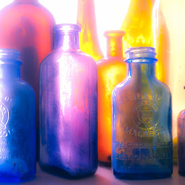 by Leann Shamash - Artistic Objects Antiques ( red, antique store, july 2014, purple, blue, yellow, memphis antiques, colored glass )