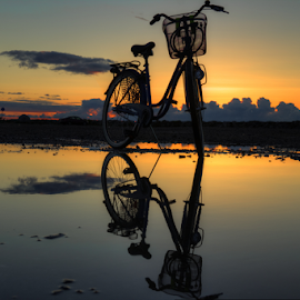 The reflection by Julija Moroza Broberg - Transportation Bicycles ( water, reflection, shallow, sea, transportation, bicycle, soft, biek, transport, sunset, puddle, low, evening, rain )