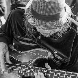 Deep in the Groove  by Phillip Gandy - People Musicians & Entertainers ( bass, atlanta, street performer )