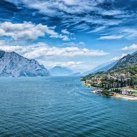 Lake Garda by Dobrinovphotography Dobrinov - Landscapes Travel ( mountain, europe, travel, landscape, sky, color image, nature, italy, travel destinations, travel locations, water, colors, scenics, western europe, horizon, lake, clear sky, southern europe, blue, mountain range, extreme terrain, horizontal, outdoors, moody sky, lake garda, day, horizon over water )
