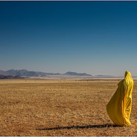 Figure in Yellow by Rick Venter - Landscapes Prairies, Meadows & Fields ( expanse, yellow, namib rand, africa, namibia )