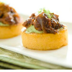 Seared Cheddar Polenta Rounds with Barbecued Chicken and Avocado Sauce