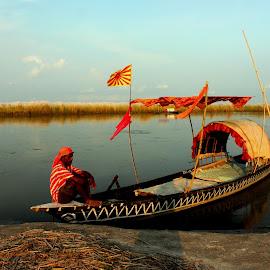 waiting alone by Santanu Dutta - Transportation Boats