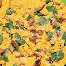 Scrambled Eggs with Leeks, Fava Beans, Crispy Breadcrumbs, and Parmesan