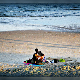 Watching the Sunset ! by Linda Blevins - People Couples ( water, sand, couple, beach )