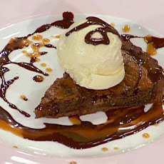 Warm Chocolate Praline Tart with Caramel, Chocolate Sauce, and Vanilla Ice Cream